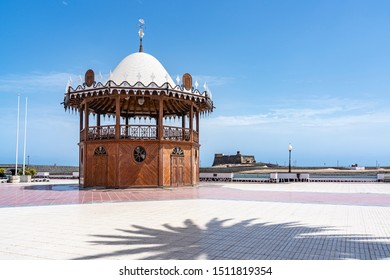 On the promenade, a lovely old bandstand and in the background the old fortress (Castillo de San Gabriel) in Arrecife, Lanzarote, Spain