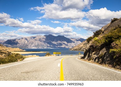 On the road between lake Hawea, in the background, and lake Wanaka near the tourism town of Wanaka in Canterbury district of New Zealand south island.