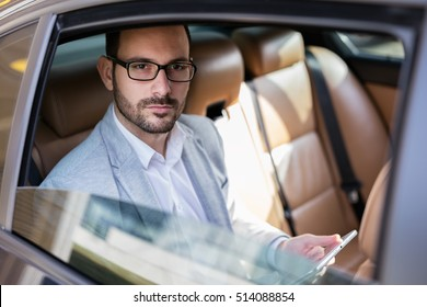 On the road to success. Handsome businessman in car. brown hair