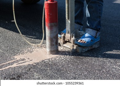 on the road surface of the street is drilling with steel from the new asphalt with a diamond drill