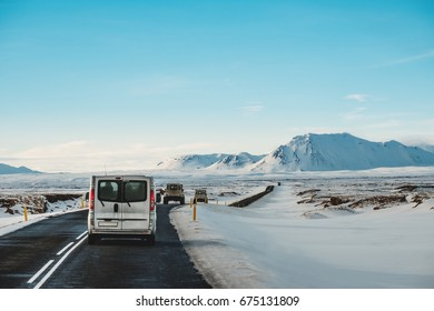 On the road in winter, with a cars driving on highway in Iceland
