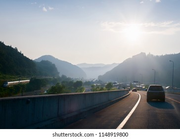 On the roads of Tohoku in Japan by summer. Sunbeam and nature surrounding the highway.