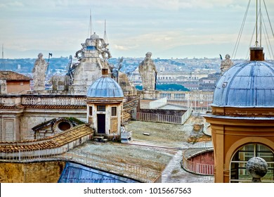 on the roof of the peters dome, Vatican, Rome, Italy with sculpture and cloudy skay in the background