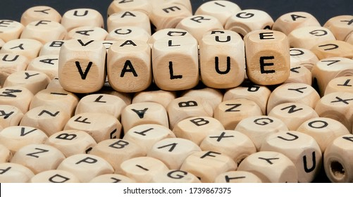 On the scattered cubes with letters on top is the word VALUE