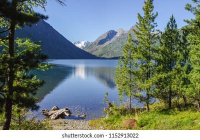 On the shore of a beautiful mountain lake, Multinsky Lakes in the Altai