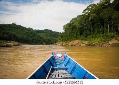 On a small boat to Tad Sae Waterfall in Luang Prabang Province, Laos.