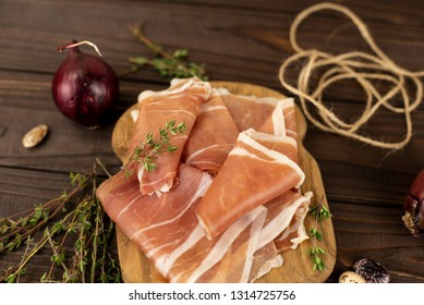 Jamón on a small wooden tray close up