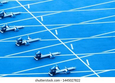 On starting block ready for sprint start.  Blue color filter