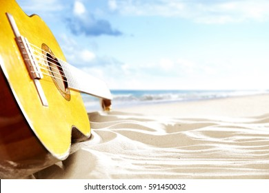 on a sunny beach guitar and suitcase