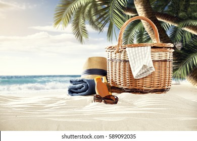 on a sunny beach in the shade of palm trees stands a picnic basket