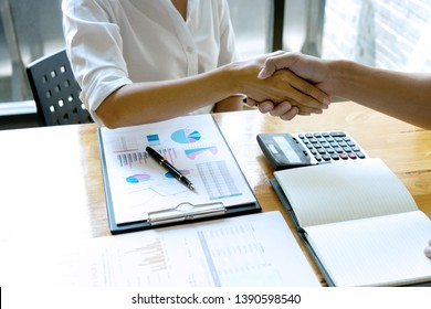 on the table business people hand shake with another business man woman on the table show their working about analysis marketing have graph chart on the table