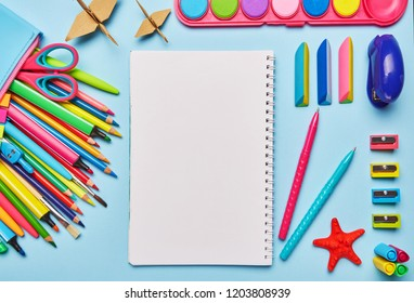 On the table is a composition from school stationery. Colorful Back to School background. 1 September concept postcard. Top view, Flat lay. copyspace