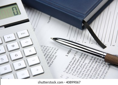 On a table the pen, the calculator, the contract, the diary