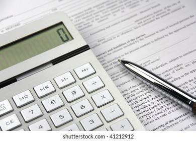 On a table the pen, the calculator, the documents