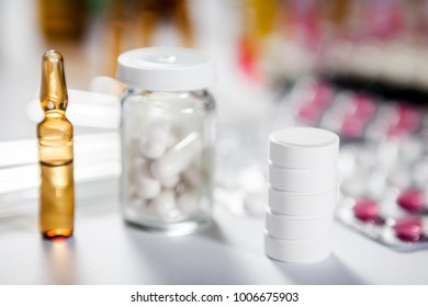 On the table there are ampoules next different pills drugs and medications. With copy space for your text
