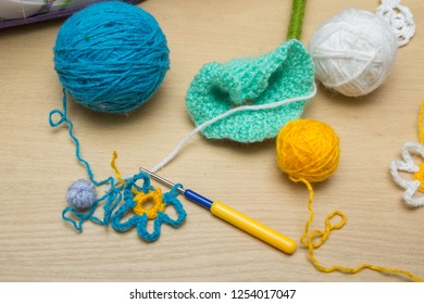 On the table there is a set for needlework - knitting needle, thread, clews