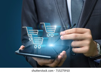 On the tablet the businessman makes a purchase in the online store.