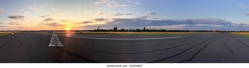 On Tempelhofer Feld on a summer evening in Berlin, Germany.