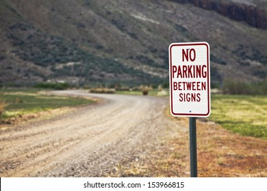 On this countryside road this sign is missing the other sign in view to know where not to park.