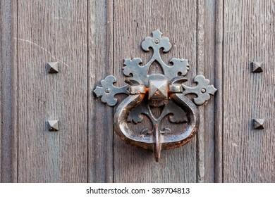 on this wooden doors you find these Door knockers