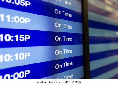 On Time board listing arrivals and departures. Airport schedule