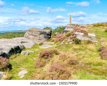 On the top of Birchen Edge rugged gritstone rocks lead up to a 200 year old monument to Admiral Nelson. HDR image