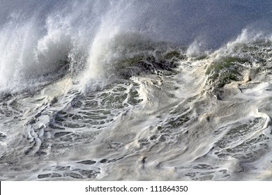 On top of a large and powerful ocean wave in Portugal