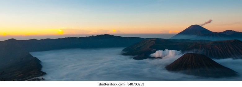 On the top of smoking mountains with thick layer of sulfur mist and smoke at volcano bromo