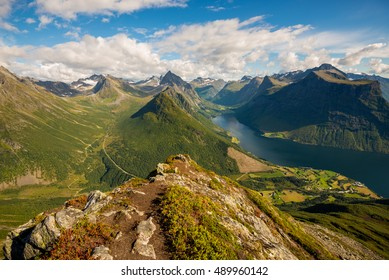 On top of the summit of Mount Saksa with incredible views of the Sunnmore Alps in Norway
