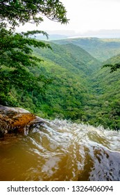 On top of a waterfall. Waterfall is  flowing down between mountains. Travelling in Malawi, Africa.