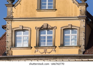 on a very sunny day end of may in south german historical city ancient facades and roofs of pastell colors are inspiring views of contemplation