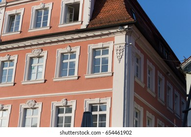 on a very sunny day in june in south germany you see facades windows and part of roofs at an historical city with ornaments