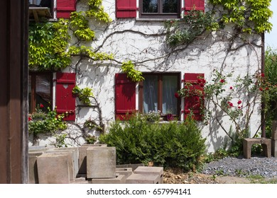 on a very sunny day in june in south germany you see details and colors of cottage country buildings and streets with vintage decoration