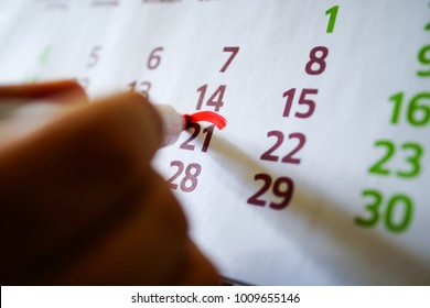 On the wall calendar, the marker marks important dates, deadline