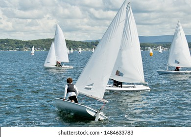 On watch in close school children sailboat racing on an inland lake. Junior sailors racing on saltwater Lake Macquarie. Photo for commercial use.