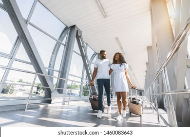 On way to honeymoon. African-american couple travelers with suitcases at airport, freee space