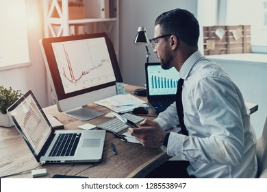 On the way to success. Young businessman in formalwear analyzing data using computer while sitting in the office