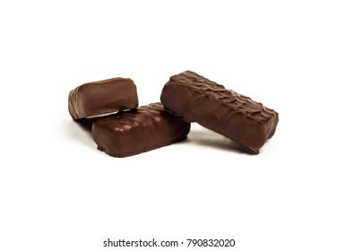 On a white background close-up are three chocolates