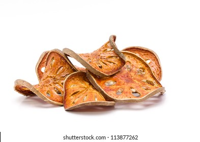 On a white background Dried Bael (Aegle marmelos).