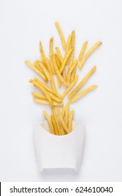 on a white background fried french fries in a white box. studio photo of fried french fries on white background