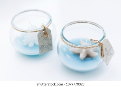 on a white background glass jar inside a candle