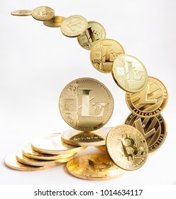 On a white background are gold coins of a digital crypto  currency - litecoins, bitcoin and ethereum