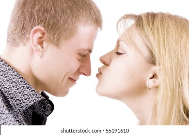 on a white background portrait of a young girl who kisses a guy