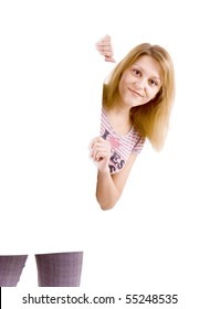 On white background the smiling young woman behind the white stand