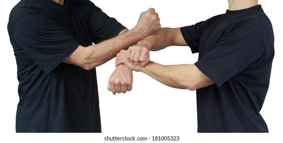 On a white background techniques of Wing Chun are performing two athletes