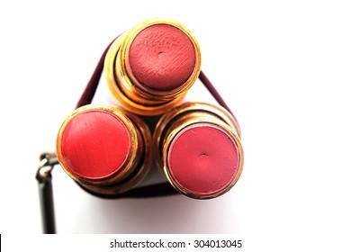 on a white background three lipsticks