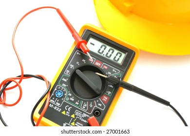 on a white background is yellow helmet and multimeter