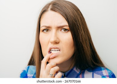on a white background a young girl toothache