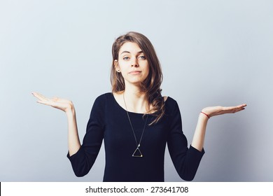 on a white background young girl throws up his hands