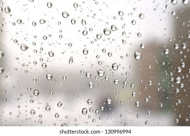 On a winter raining day. Drops of water on the window. Shallow DOF